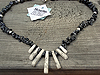 Snowflake Obsidian chips form the main body of the necklace with Howlite fan pieces in the centre. $30.00